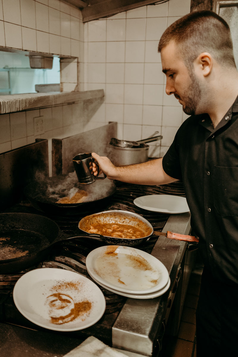 a chef cooks up a dish at saltwater cowboys