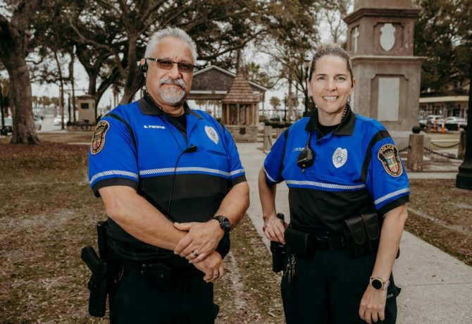 officers carol druin and steve fischer stand in the plaza in downtown st augustine