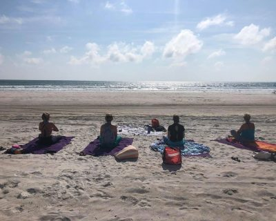 yogis with ancient city yoga on a beach in st Augustine