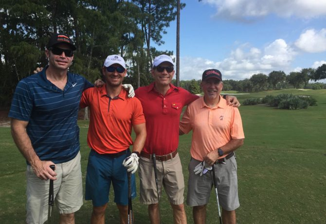 realtors from endless summer realty stand on a st johns county golf course for champions for elders
