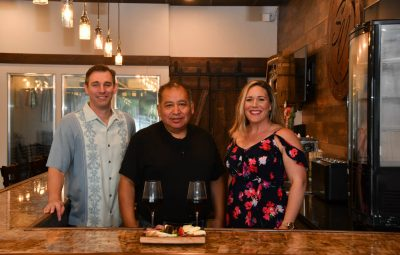 owners Alayna Brewer and Jamie Umberger in southern vibes tasting room and wine cellar