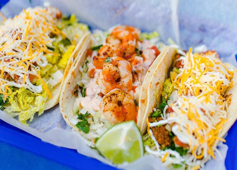 Three Tacos sit on a plate at Burrito Works Taco Shop in St. Augustine