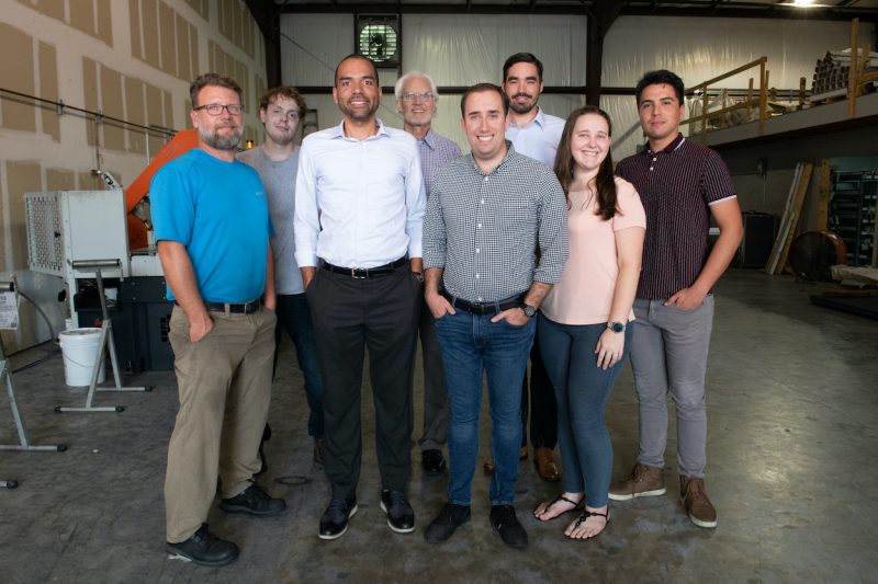 St. Augustine based company Vested Metal staff gather for a photo.